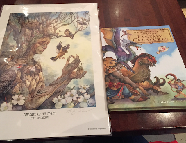 Our loot from Gen Con, a print and The Explorer's Guide to Drawing Fantasy Creatures.